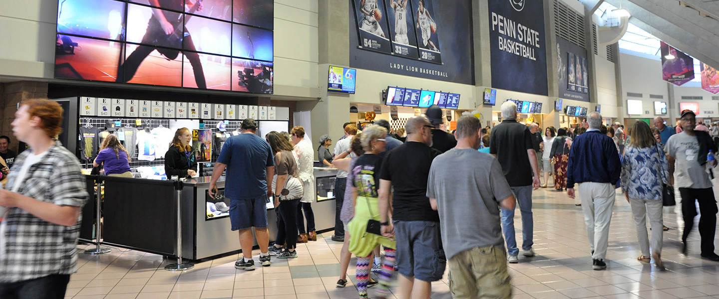 Fans walking on the concourse near concession stands