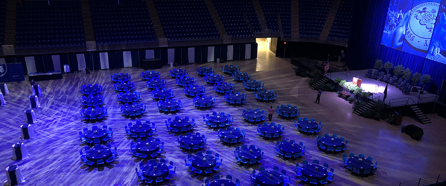 round tables set up on the arena floor of the bryce jordan center for a banquet