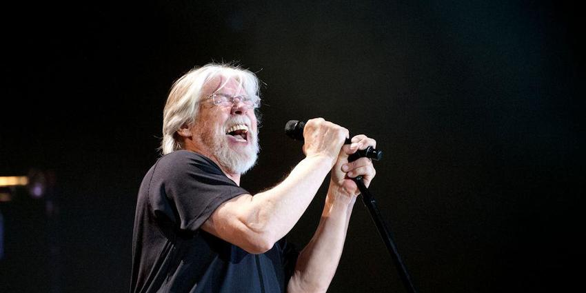 Bob Seger sings into microphone during his performance at the Bryce Jordan Center in 2013.
