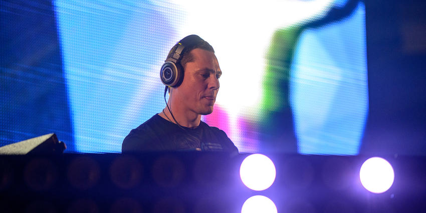 DJ Tiesto plays his electric dance music for the Bryce Jordan Center audience in 2013.
