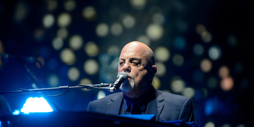 Bill Joel sings from his piano to the sold out crowd at the Bryce Jordan Center in 2014.