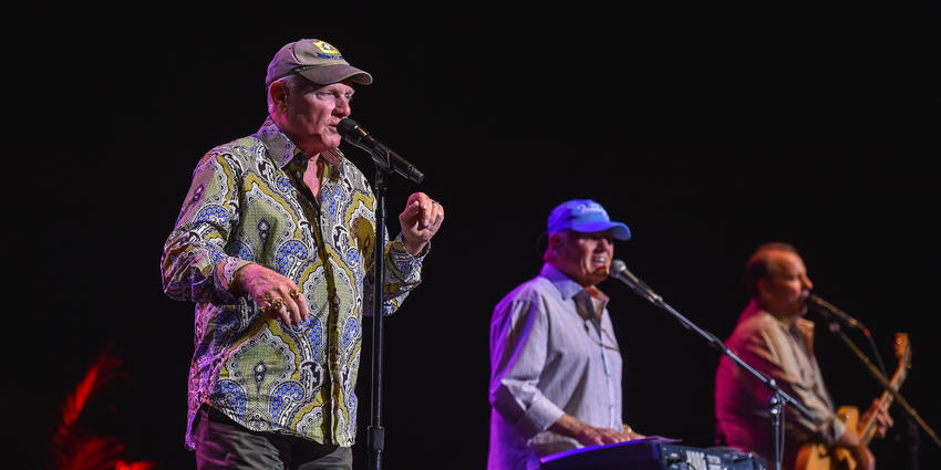 The Beach Boys sing together on stage at the Bryce Jordan Center for the audience in 2014.