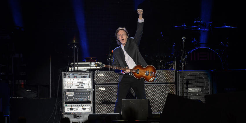 Paul McCartney, plays guitar during his first ever concert at the Bryce Jordan Center in 2015.