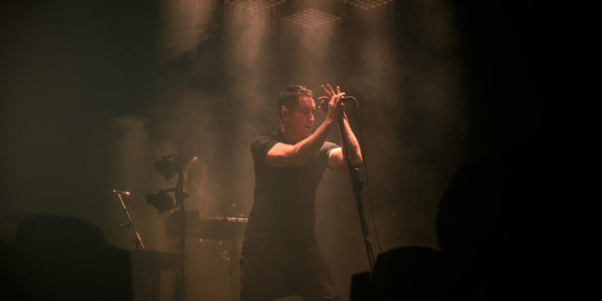 Nine Inch Nails vocalist performs under spot lights and in fog during their concert at the BJC in 2013.