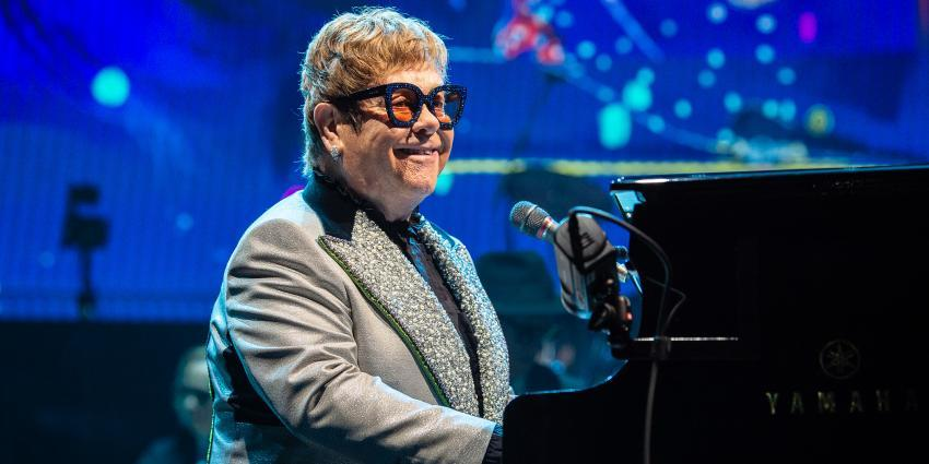 Elton John playing piano in concert at BJC
