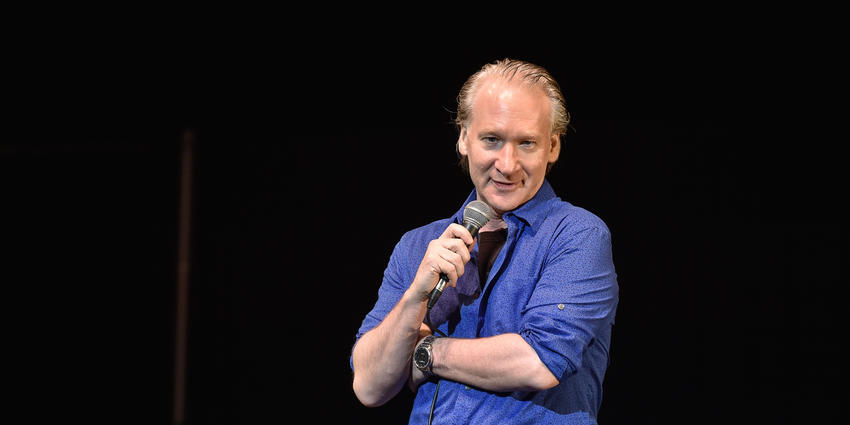 Comedian, Bill Maher, speaks with the Bryce Jordan Center audience in 2014.