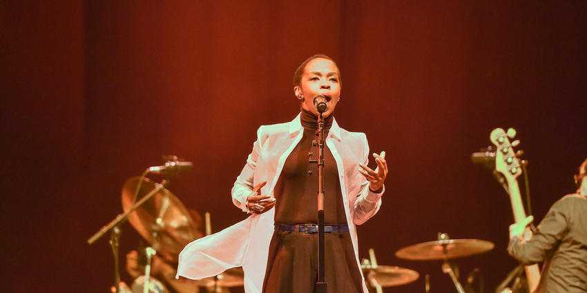 Ms. Lauryn Hill performs with band for the Bryce Jordan Center audience in 2014.