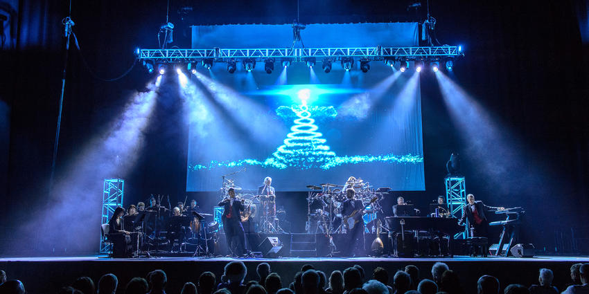 Entire Mannheim Steamroller band performs Christmas music on stage at the Bryce Jordan Center in 2013.