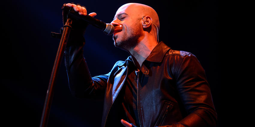 Lead singer of Daughtry sings into standing microphone during their concert at the Bryce Jordan Center in 2012.