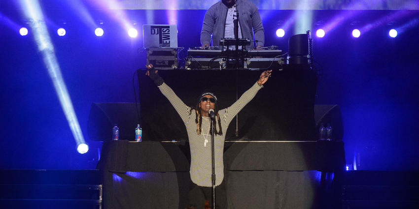 Lil Wayne raises his arms up in greeting to the crowd at the BJC in 2016.