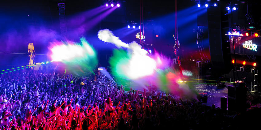 Electric musician, DayGlow, mixes dance beats and paints the crowd using paint cannons on stage at the BJC in 2012.