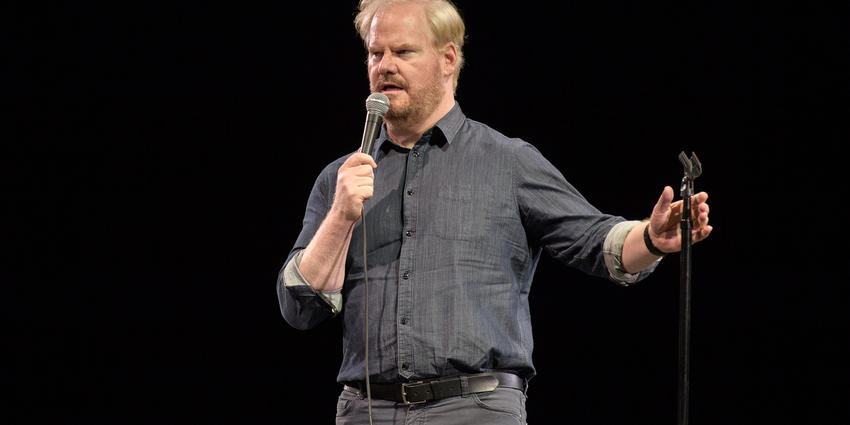 Jim Gaffigan holds mic while speaking to the crowd during his performance in 2017 at BJC
