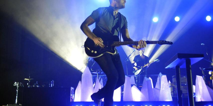 Foster the People perform on stage for the audience at the Bryce Jordan Center in 2014.