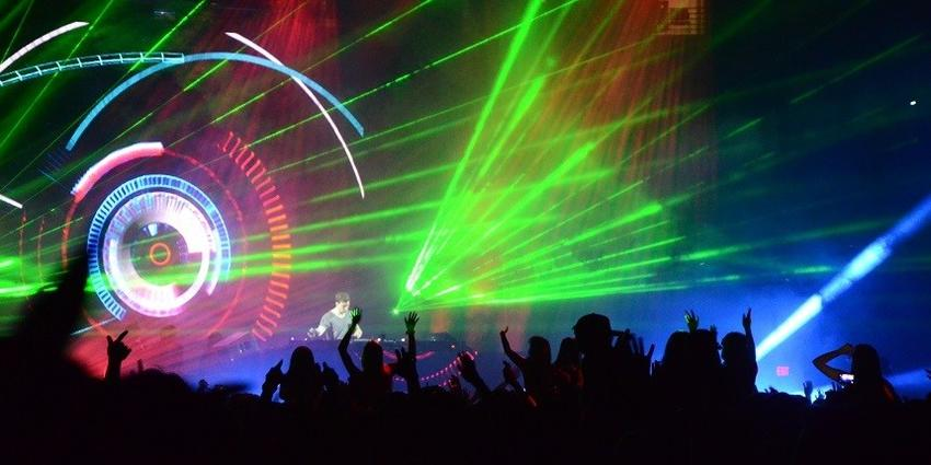 Hardwell, DJ, mixes beats on stage under a rainbow of laser and strobe lights for the dancing BJC crowd.