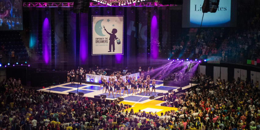 THON 2015 stage with PSU dance team performing for the packed arena dance floor.