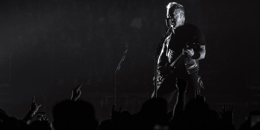 Metallica, James Hetfield singing and playing guitar during concert at BJC.
