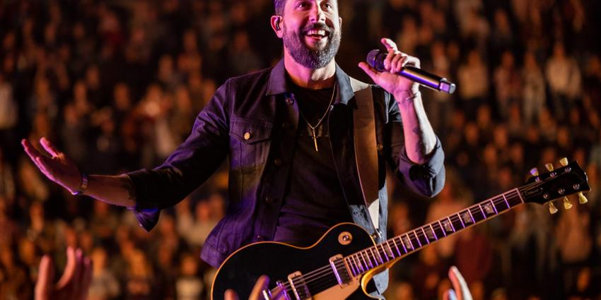 Lead singer of Old Dominion smiles for the crowd at the BJC