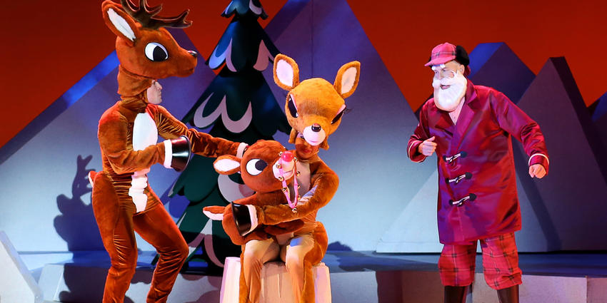Rudolph the Red Nosed Reindeer with parents and Santa on stage at the Bryce Jordan Center.