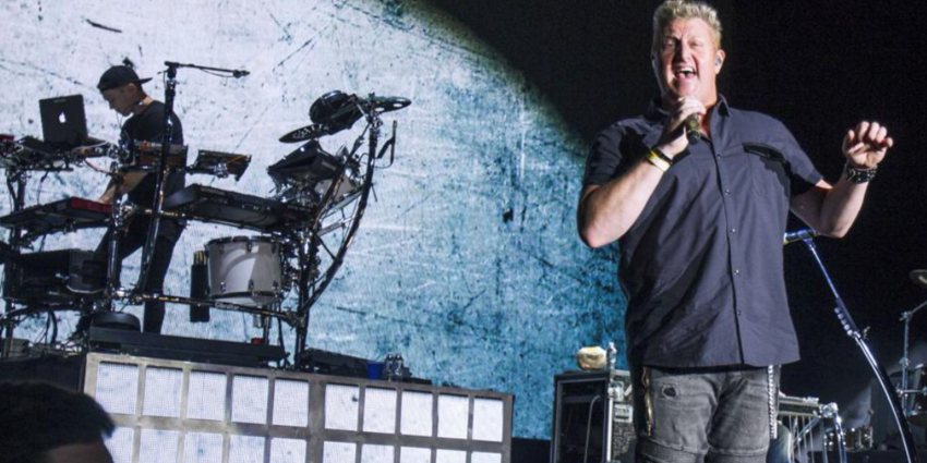 Rascal Flatts lead singer, Gary LeVox, sings into hand held microphone during their concert at the BJC in 2016