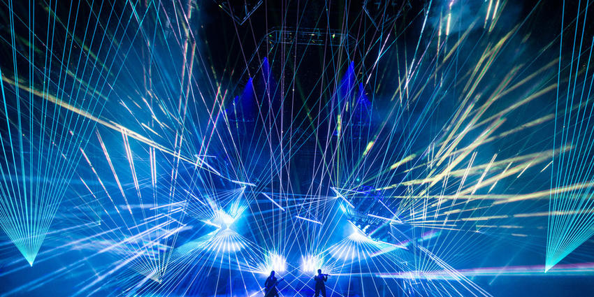 TSO perform electric rock opera with hundreds of blue strobe lights flashing in unison all across the stage