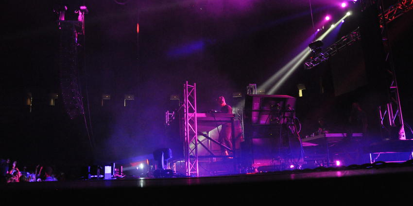 American D.J., Diplo, mixing dance music in a mix of purple pink lights for the crowd at the BJC.