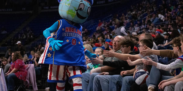 Harlem Globetrotter mascot interacts with fans in 2020