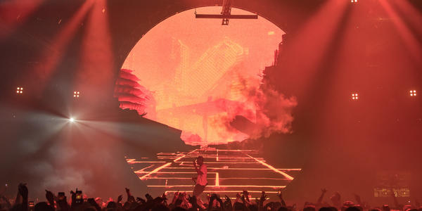 Travis Scott performs on stage for a large crowd at Bryce Jordan Center