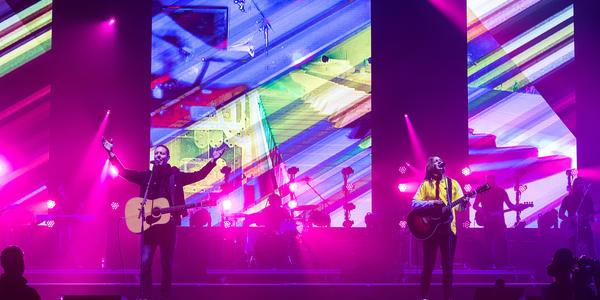 Closeup of worship team singing with pink back lighting
