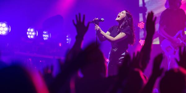 Closeup of female worship singer during Winter Jam Spectacular Tour