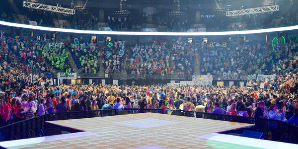View of THON from the stage, all dancers & full seats in crowd