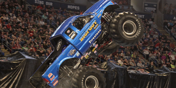 Monster Truck, BIGFOOT, does a wheelie on the arena floor of the BJC