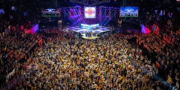 View of all dancers on the floor with Nittany Lion on stage