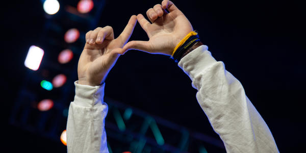Dancer hands making the THON diamond