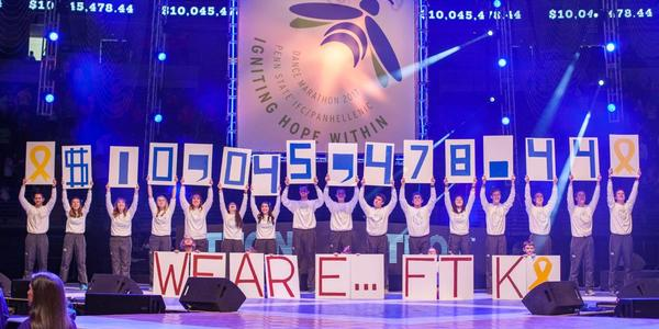 Reveal of amount raised on stage.  Each Thon member holds a number above their head.